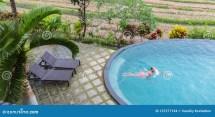 Luxury Resort. Man Relaxing In Infinity Swimming Pool