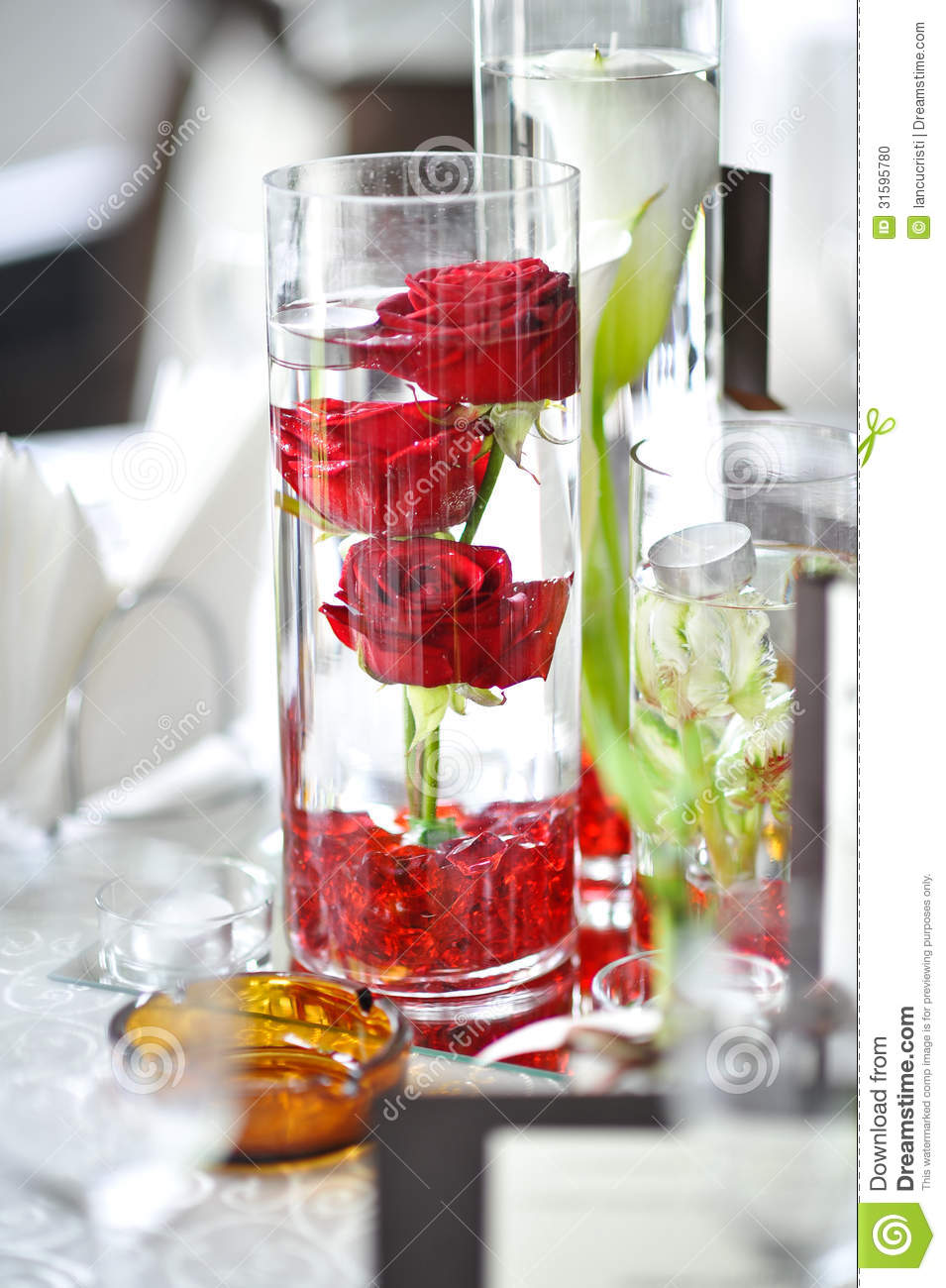 Luxury Wedding Decoration With Red Roses In A Glass Stock