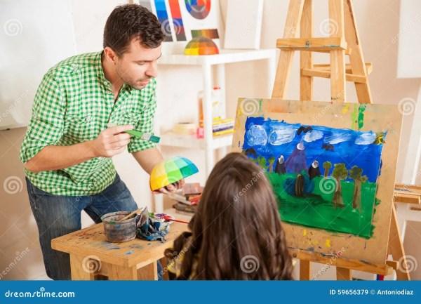 Male Art Teacher Helping Student Stock - Of