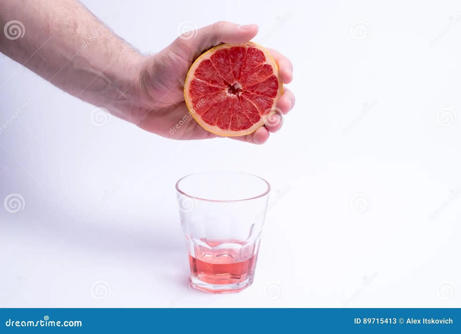 Male Hand Gripping Grapefruit Grapefruit Juice On White ...