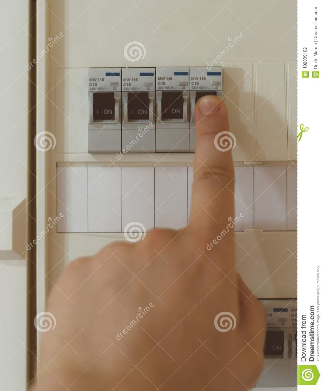 hight resolution of male hand switching on fuse board