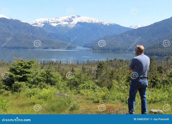 man in alaska landscape stock