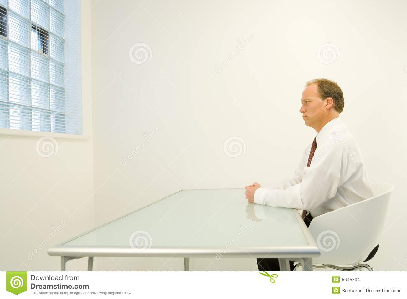 Man alone in white room stock photo Image of businessman