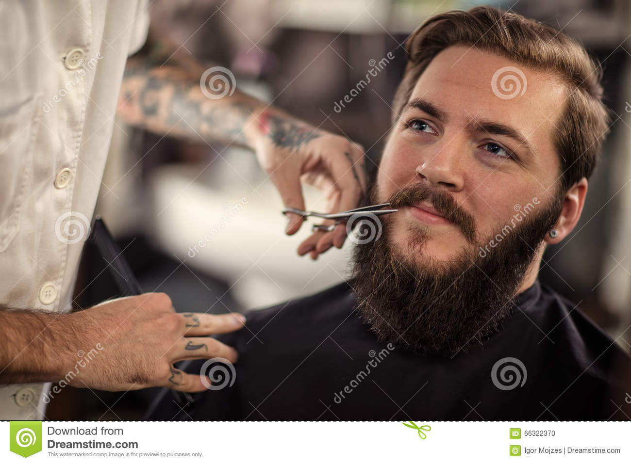 Man Barber With Scissors Cut The Mustache Stock Photo