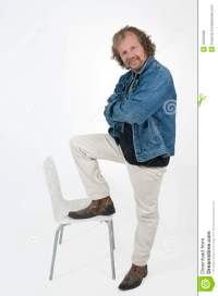 Man and chair stock photo. Image of position, denim, chair ...