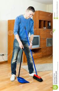 Man Sweeping The Living Room Stock Photo | CartoonDealer ...