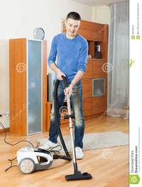 Man Cleaning With Vacuum Cleaner In Living Room Stock ...