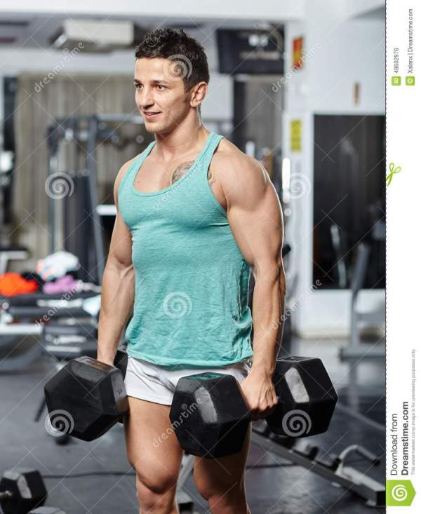 Man Doing Workout With Heavy Dumbbells Stock Photo Image