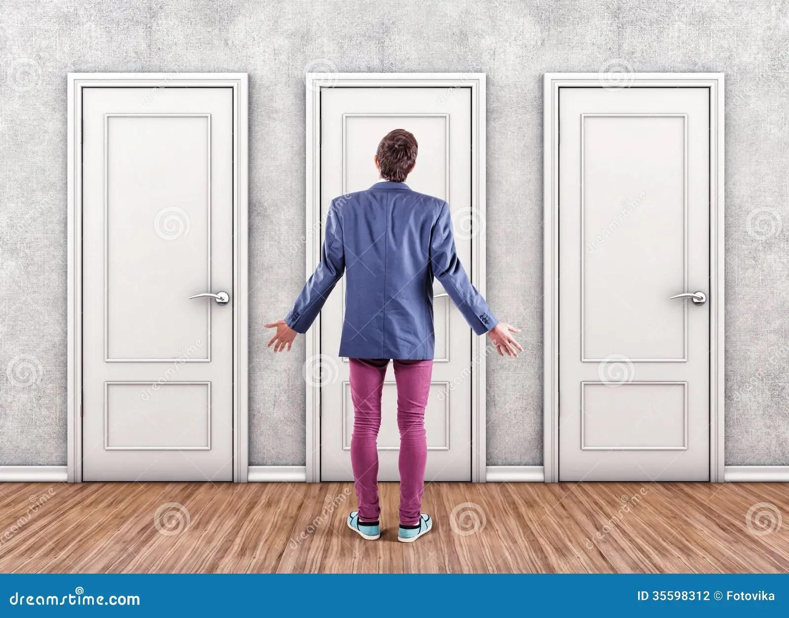 Man before a doors stock photo. Image of doors