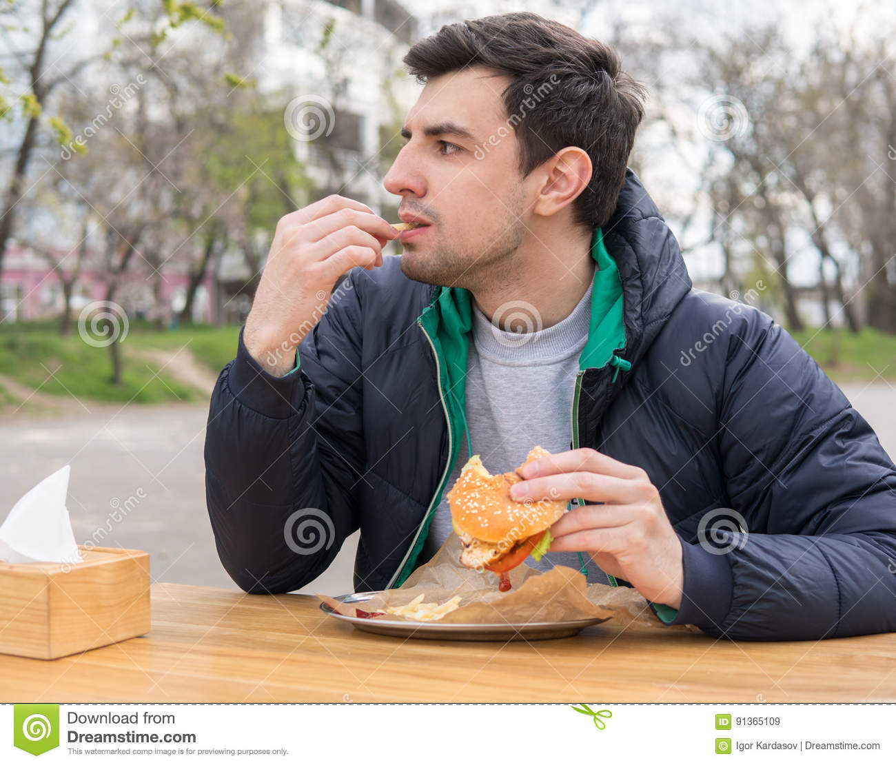 man is eating french fries in a snack bar stock image image of excited lunch 91365109