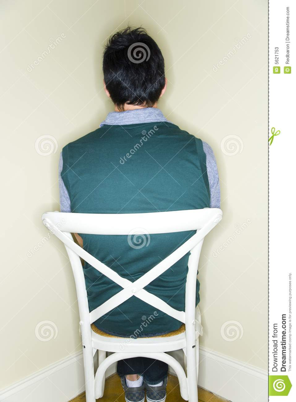 woman sitting in chair unusual pads man facing the wall stock photos - image: 5621753