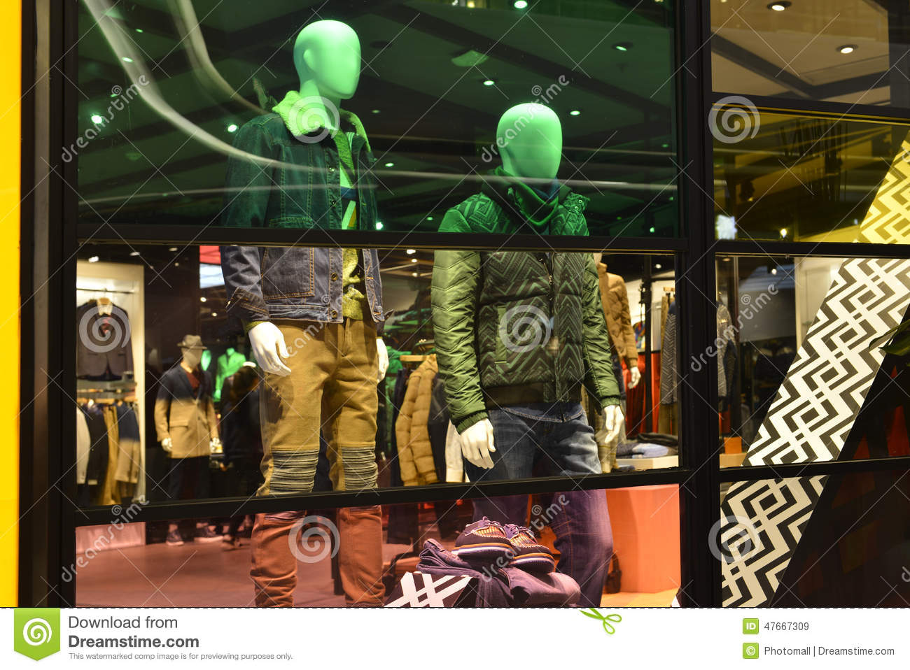 Man Fashion Clothing Shop Window With Mannequins