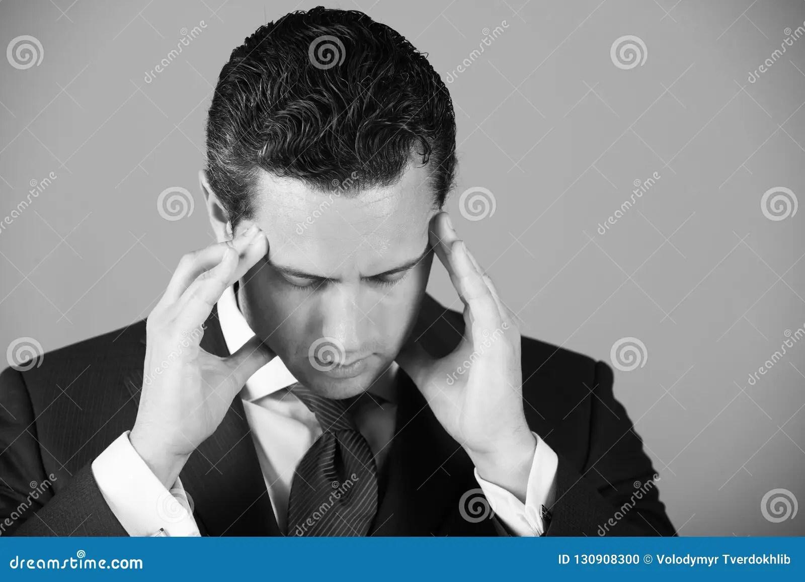 man feeling headache with