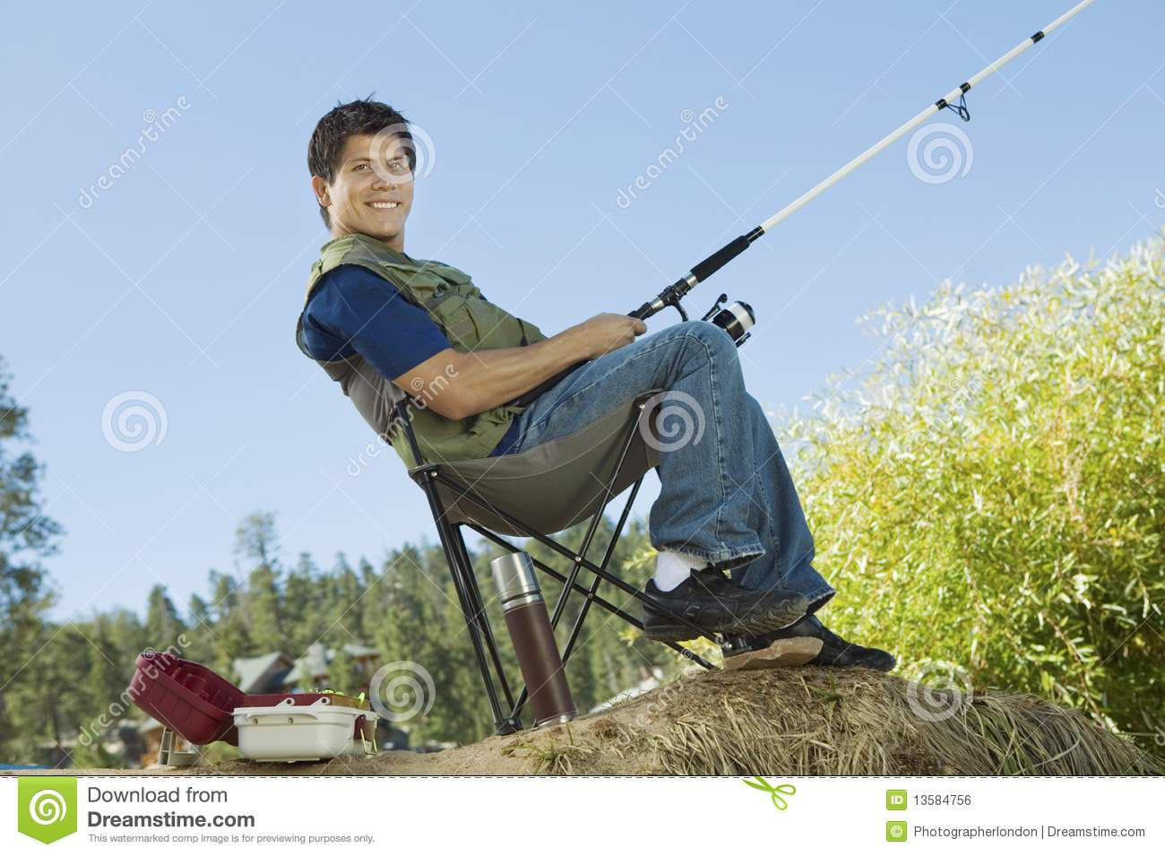 fishing chair add ons linen dining room chairs man fly sitting on collapsible stock photo