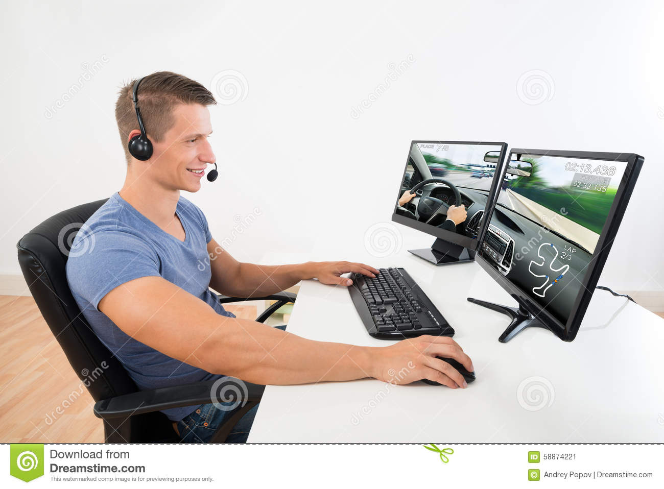 Man With Headset Playing Game On Computer Stock Image