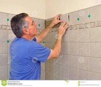 Man Installing Ceramic Tile In Bathroom Stock Photography ...