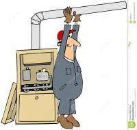 Man Installing A Furnace Stock Photography