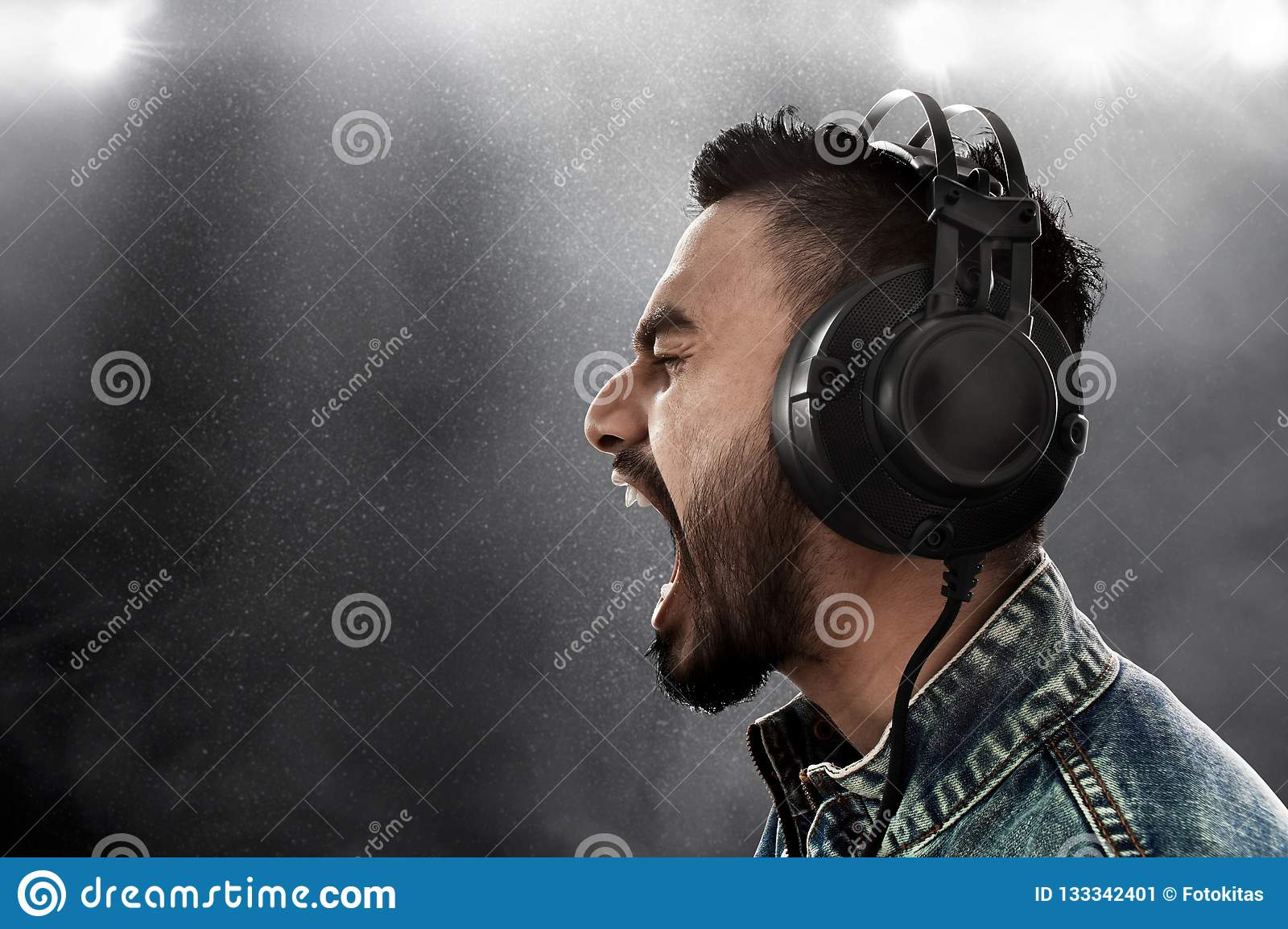 man listening music wearing