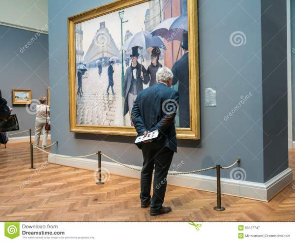 Man Reads Exhibition Label Caillebotte' Paris Street Art Editorial