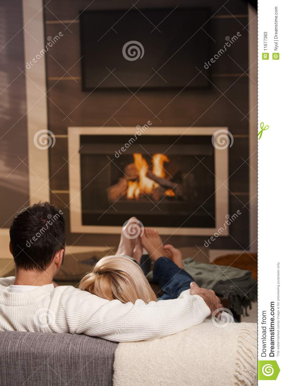 Couple Relaxing In Front Of Fireplace Man Looking At Woman Stock Man Sitting At Fireplace Stock Photos - Image: 11677383