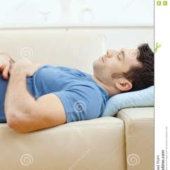 4 Person Reclining Sofa Thomas Futon Bed With Storage Man Sleeping On Couch Stock Photography - Image: 11412252