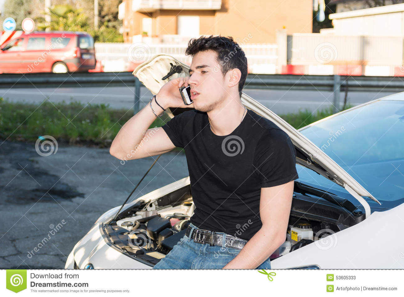 Man Trying To Repair A Car And Seeking Help Stock Image