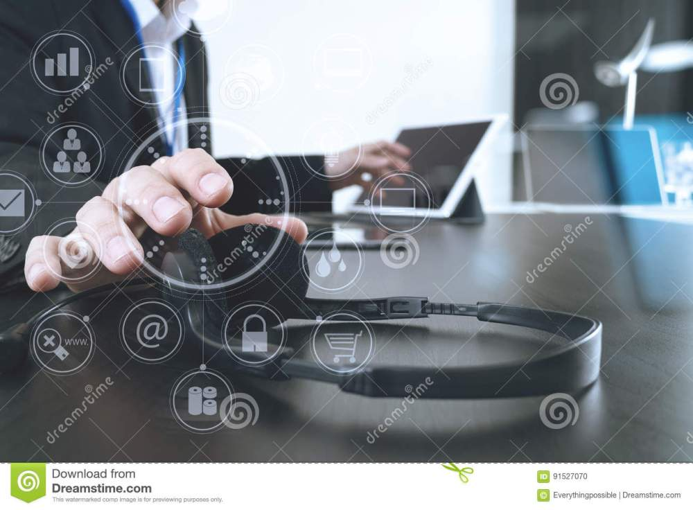 medium resolution of man using voip headset with digital tablet and laptop computer a