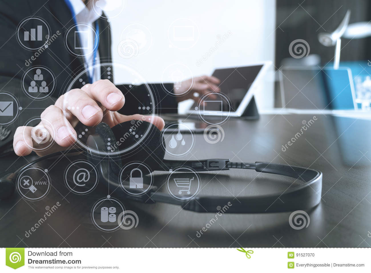 hight resolution of man using voip headset with digital tablet and laptop computer a