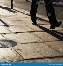Old Person Walking On Sidewalk