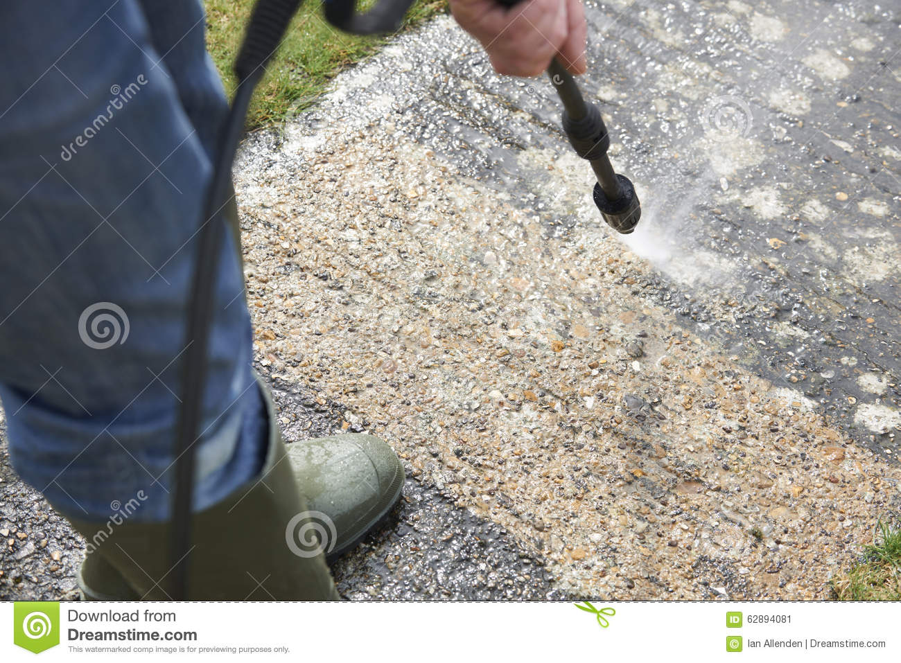 Man Washing Concrete Path With Pressure Washer Stock Image