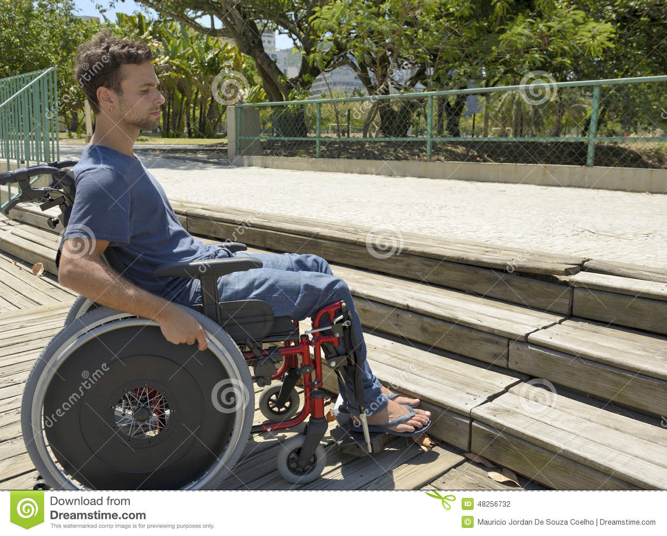 wheelchair up stairs counter chairs with arms man in front of stock photo image