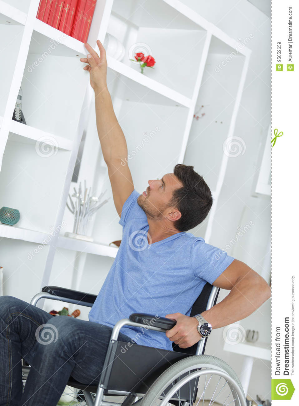 Man On Wheelchair Reaching For Book Stock Image  Image