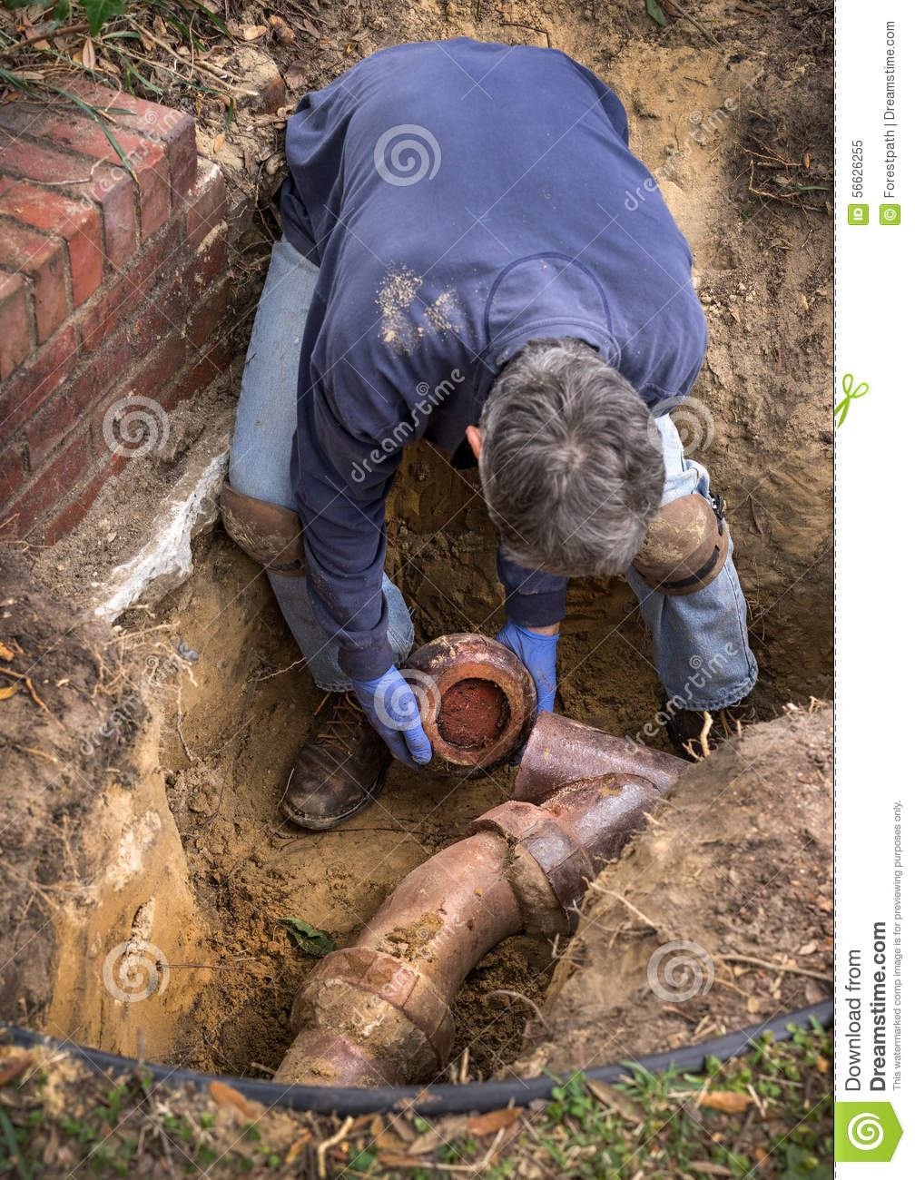 Man Working On Old Clay Ceramic Sewer Line Pipes Stock Image  Image 56626255