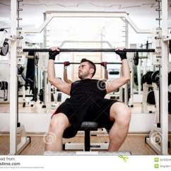 Gym Chest Chair Wingback Dining Chairs Canada Man Working Out At Bench Press Exercise Stock