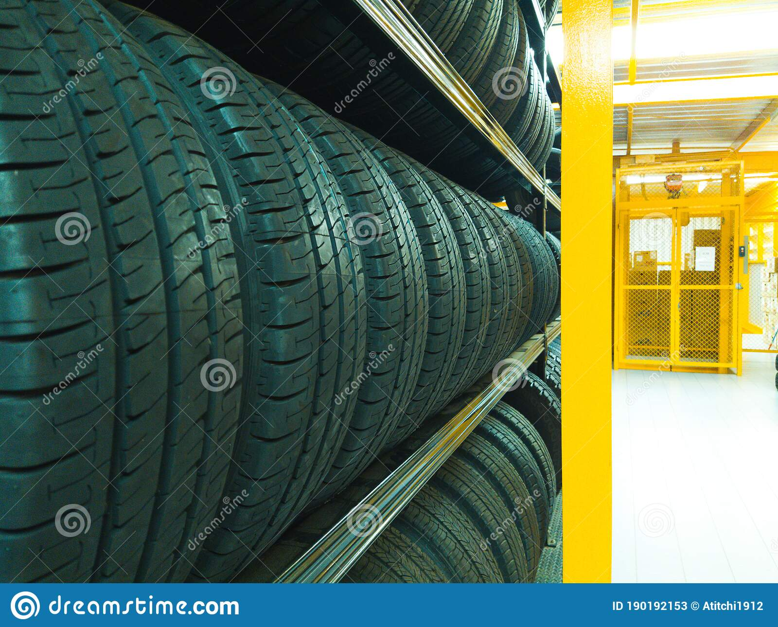 many new car tires are lined up on a tire rack stock image image of closeup transportation 190192153