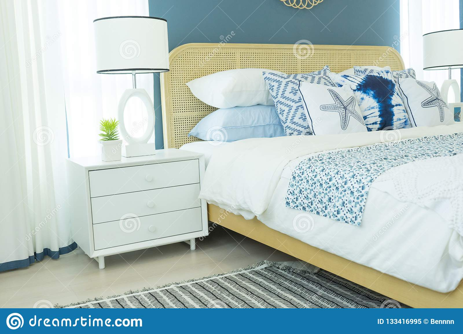 Master Bedroom With Blue Wall And White Table Lamp Stock Image Image Of Interior Home 133416995