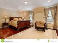 Master Bedroom With Cherry Wood Flooring Stock Photography ...