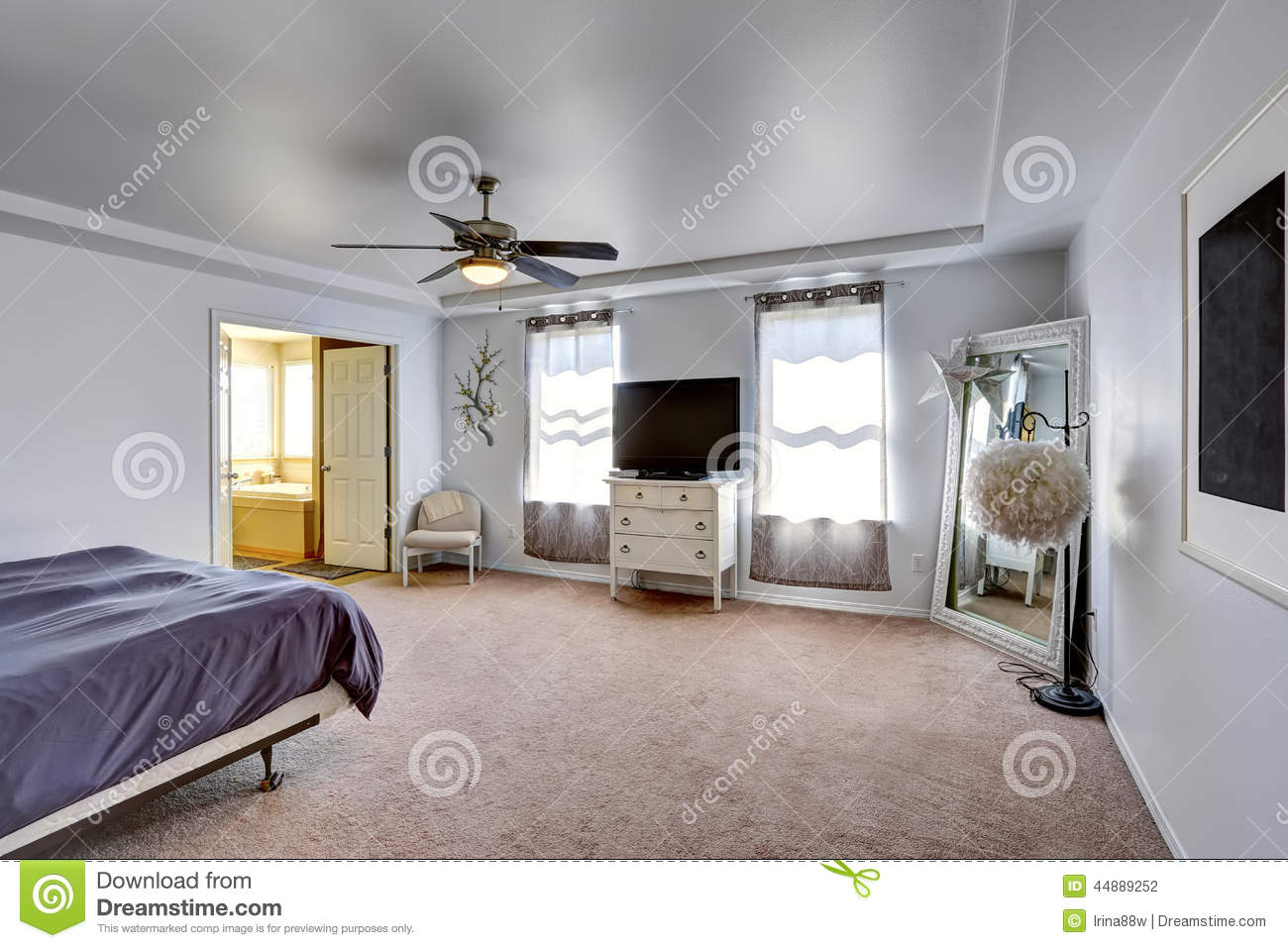 Master Bedroom With Tv And Large Mirror In The Corner