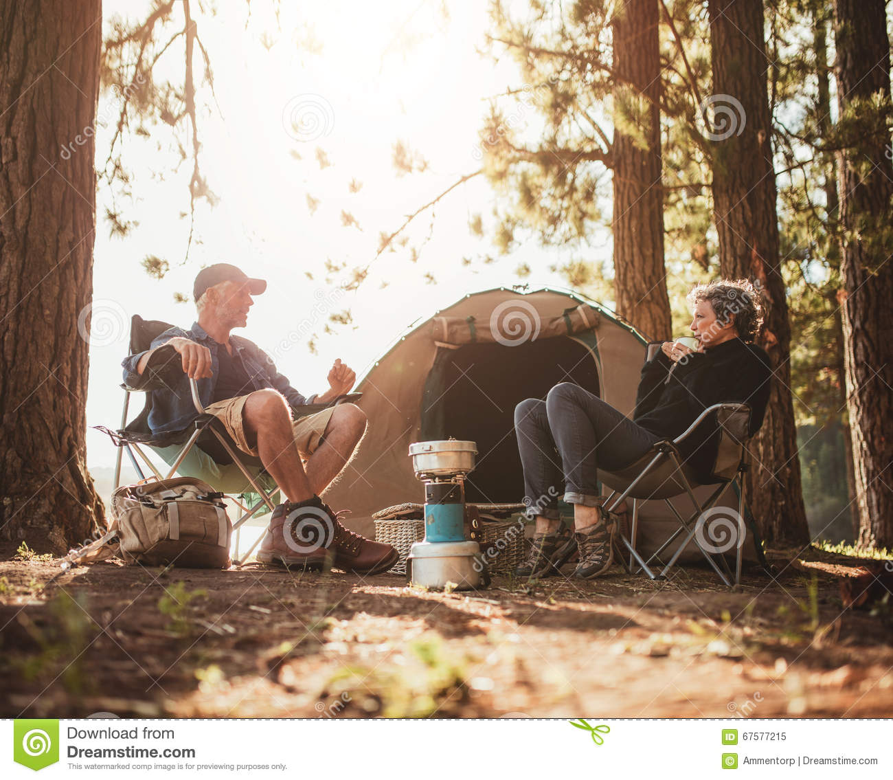 Mature Couple Camping By A Lake Stock Photo  Image 67577215