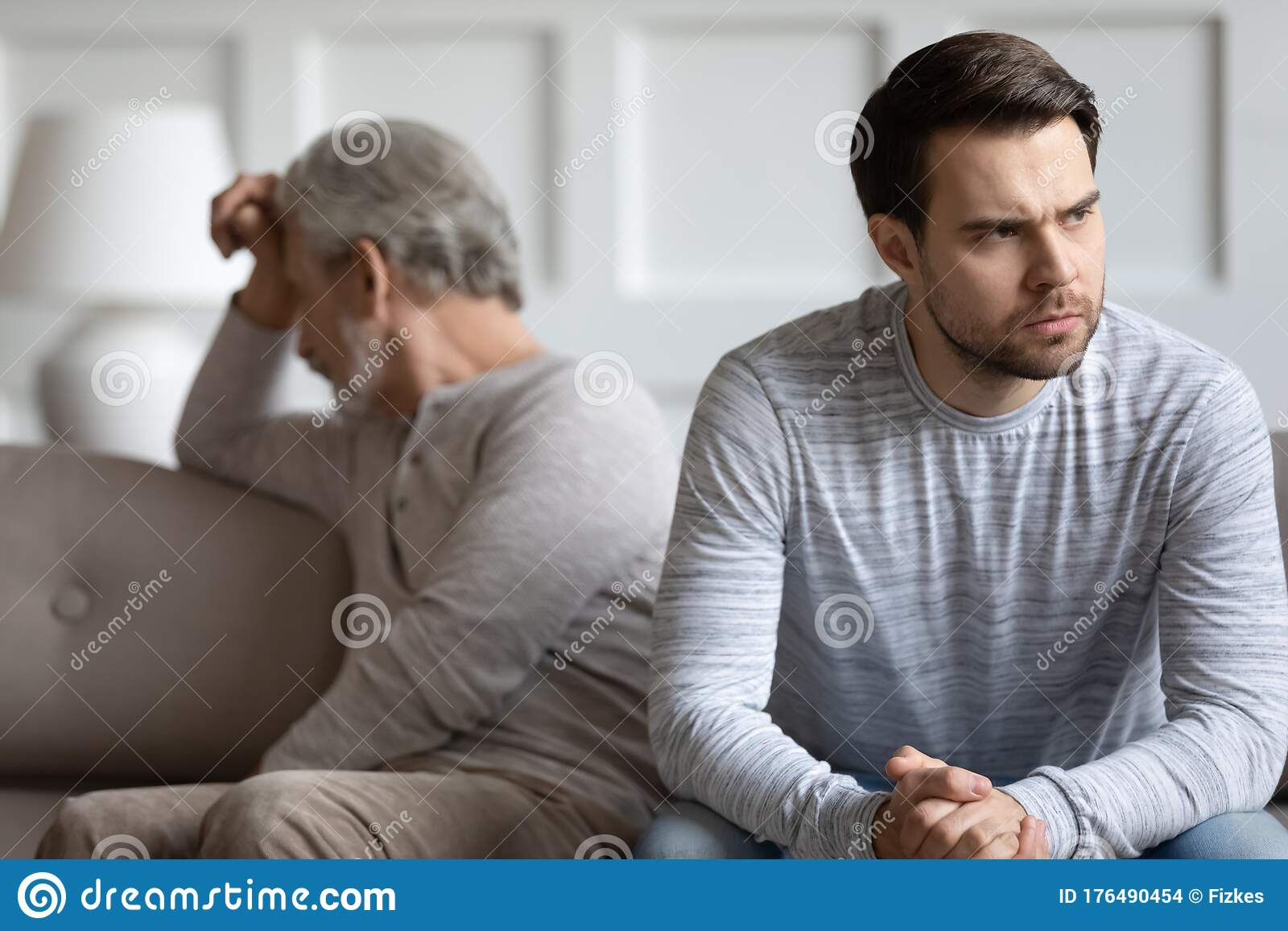 Mature Father And Adult Son Have Family Conflict Stock