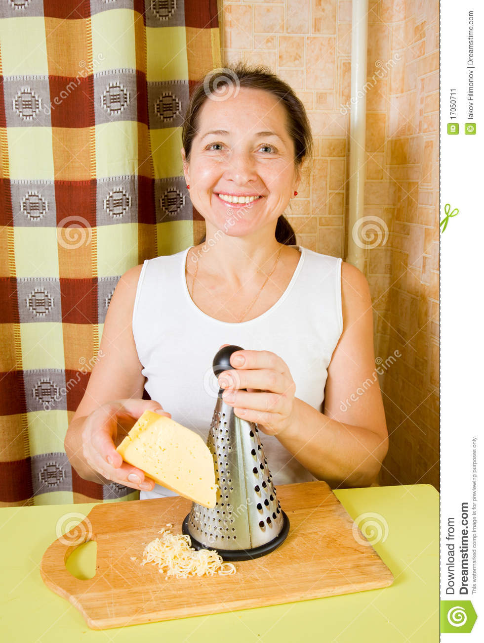 Mature Woman Grating Cheese Stock Image  Image 17050711