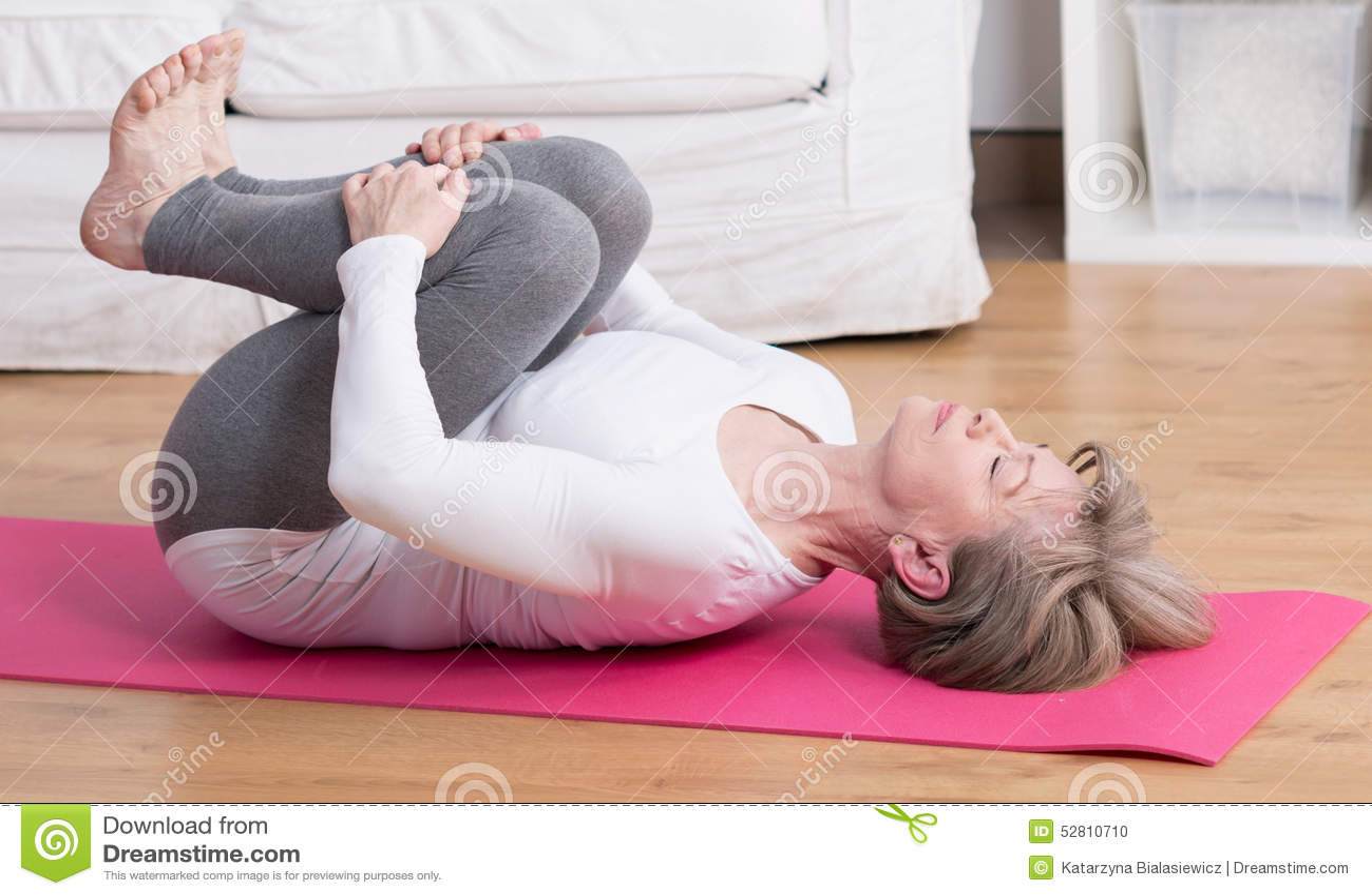 Mature Woman Practicing Pilates Stock Photo  Image 52810710