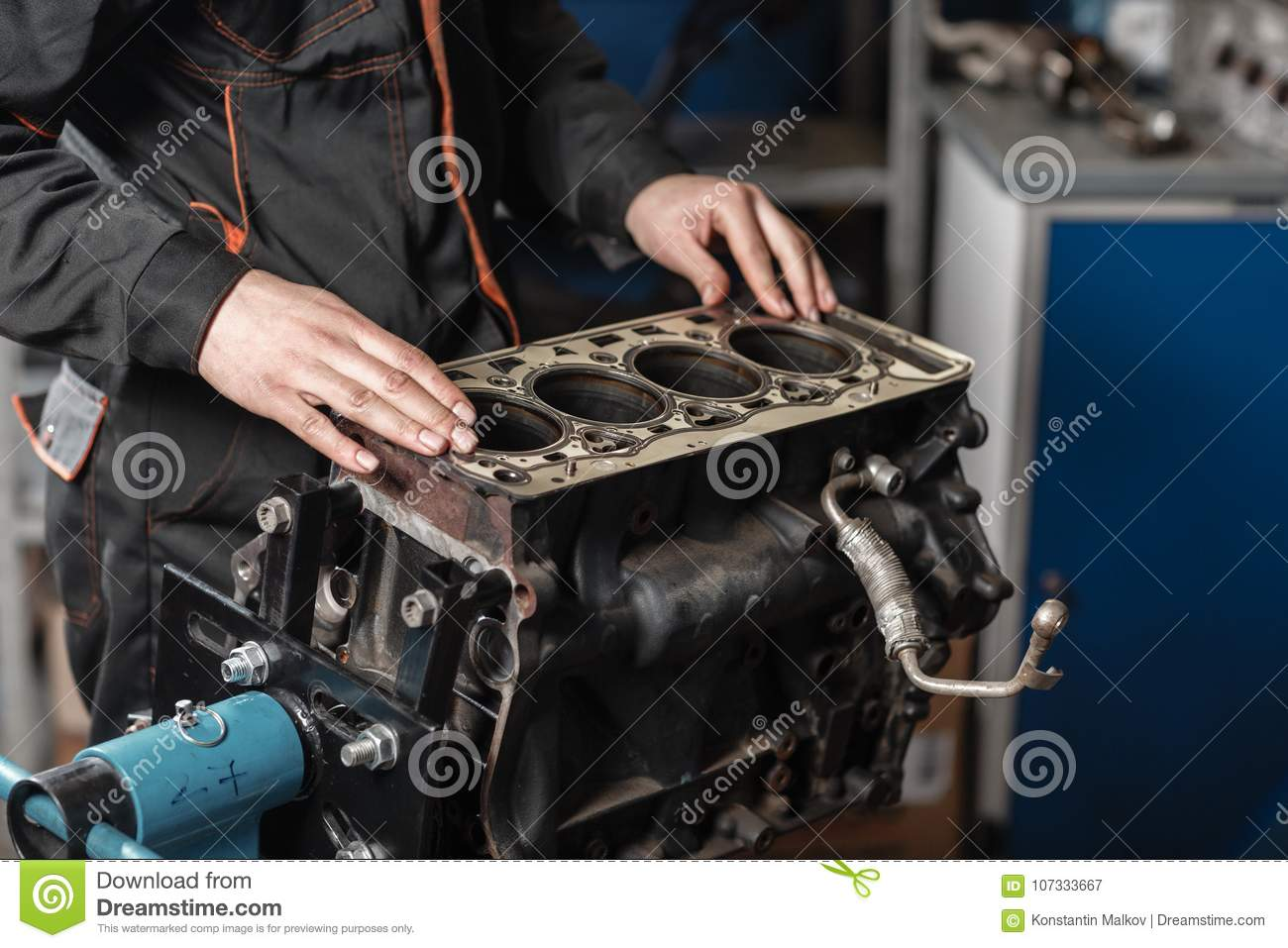 hight resolution of the mechanic disassemble block engine vehicle engine on a repair stand with piston and connecting