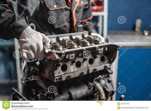 small resolution of the mechanic disassemble block engine vehicle engine on a repair stand with piston and connecting