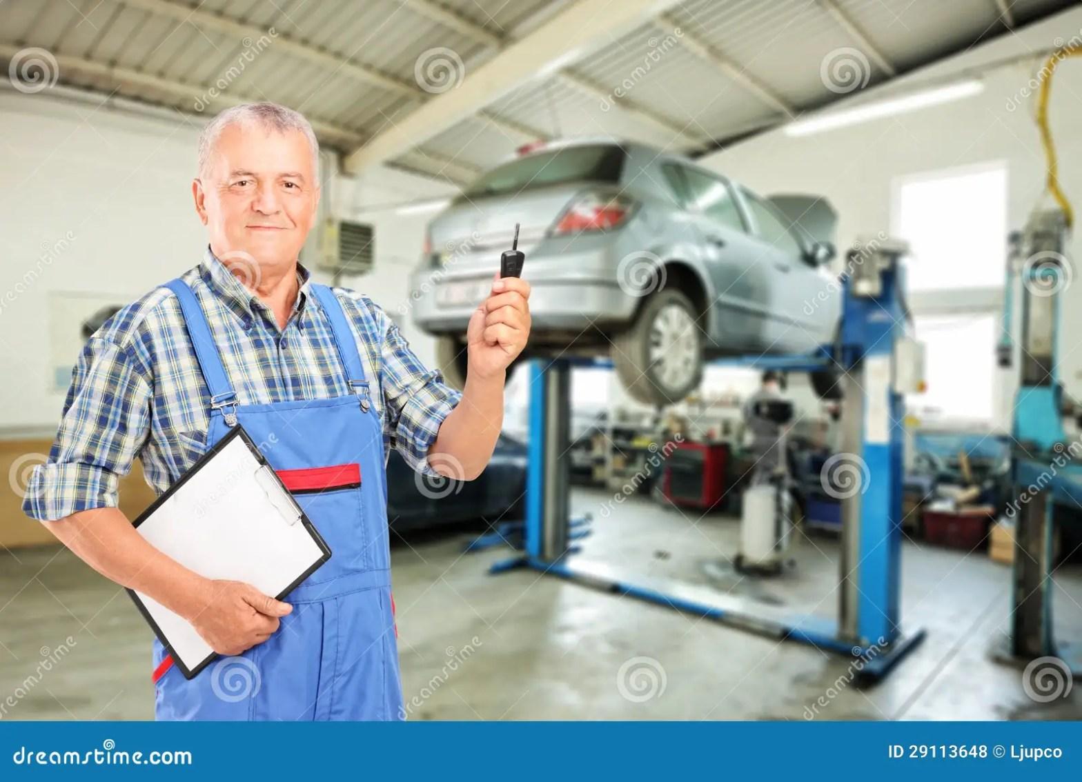 Mechanic Holding A Car Key Atauto Repair Shop Stock Photo