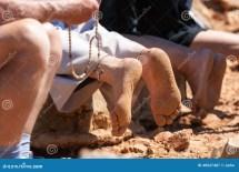Person Kneeling On Feet