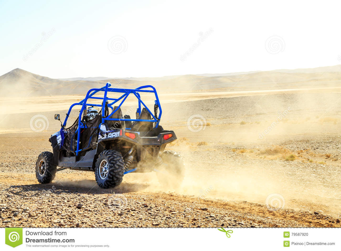 hight resolution of merzouga morocco feb 25 2016 back view on blue polaris rzr 800 with it s pilot in morocco desert near merzouga merzouga is famous for its dunes