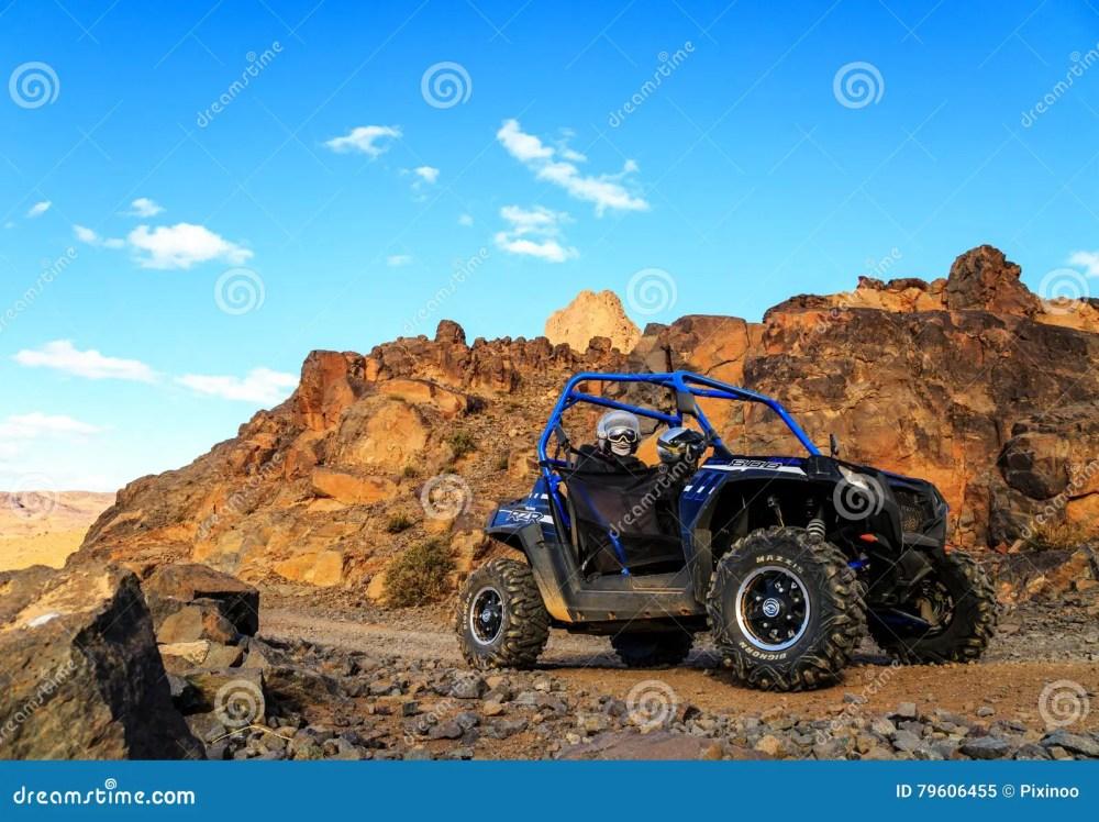 medium resolution of merzouga morocco feb 21 2016 blue polaris rzr 800 crossing a mountain road in the moroccan desert near merzouga merzouga is famous for its dunes