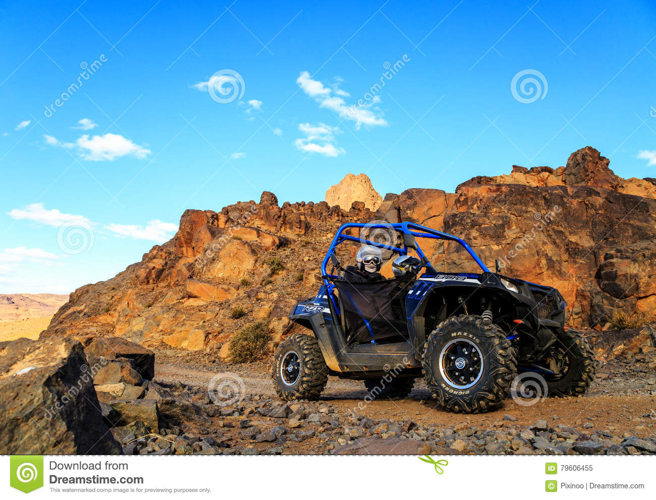 hight resolution of merzouga morocco feb 21 2016 blue polaris rzr 800 crossing a mountain road in the moroccan desert near merzouga merzouga is famous for its dunes