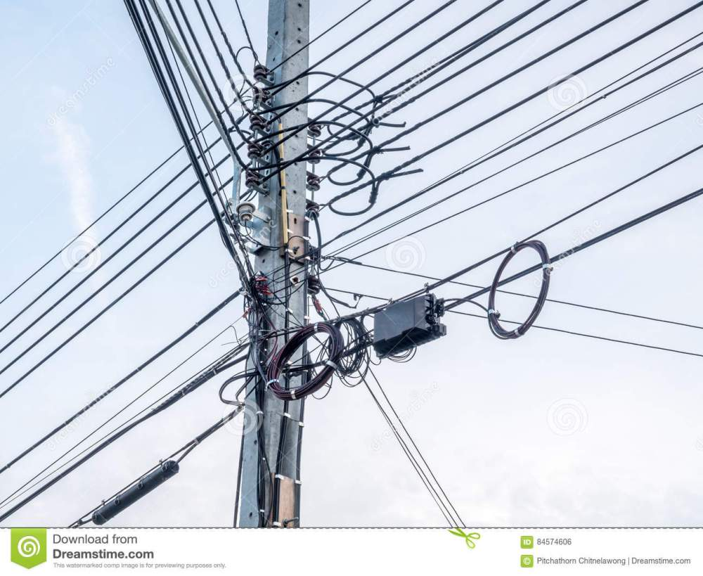 medium resolution of mess electric and telephone cables on outdoor pole in bangkok